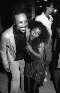Quincy Jones and Chaka Khan (George Johnson in background) at a listening partycirca 1980s© 1980 Bobby Holland - Image 24331_0150