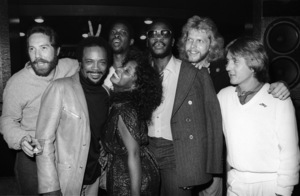 "Quincy Jones with Chaka Khan, Tony Maiden, Kevin Murphy, John ""J.R."" Robinson, Bobby Watson, Dave ""Hawk"" Wolinski and George Johnson  circa 1980s© 1980 Bobby Holland - Image 24331_0154"