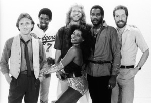 "Rufus and Chaka Khan (Bobby Watson, John ""J.R."" Robinson, Tony Maiden, Kevin Murphy, Chaka Khan, Dave ""Hawk"" Wolinski) during the making of two music videos for the album ""Masterjam""1979© 1979 Bobby Holland - Image 24331_0172"