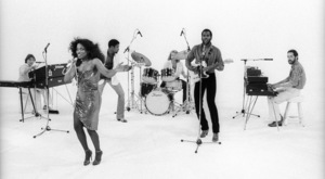 "Rufus and Chaka Khan (Bobby Watson, John ""J.R."" Robinson, Tony Maiden, Kevin Murphy, Chaka Khan, Dave ""Hawk"" Wolinski) during the making of two music videos for the album ""Masterjam""1979© 1979 Bobby Holland - Image 24331_0176"