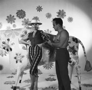 Mario Casilli takes a light meter reading on model Sandra (Sandy) Warner during the album cover session for Martin Denny