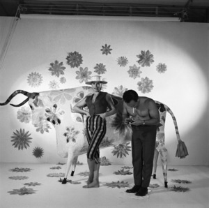 Mario Casilli takes a light meter reading on model Sandra (Sandy) Warner during the album cover session for Martin Denny