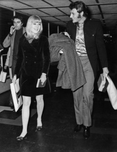 Johnny Hallyday at London Airport with his wife, Sylvie Vartan, before leaving for Paris1966** J.C.C. - Image 24380_0002