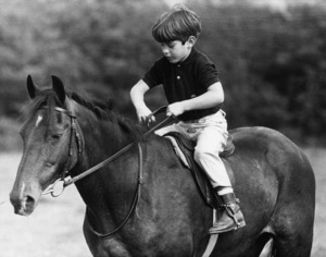 John F. Kennedy Jr. on a pony called Pal, at Woodstown, County, Waterford, in Eire while spending a month