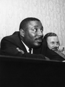 Dick Gregory at the Feathers public house in Tudor Street, just off of Fleet Street where he held a press conference in London1966** J.C.C. - Image 24380_0100