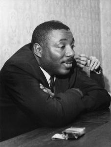 Dick Gregory at the Feathers public house in Tudor Street, just off of Fleet Street where he held a press conference in London1966** J.C.C. - Image 24380_0101
