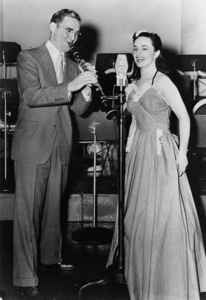 Benny Goodman and Louise Tobin during a live, Camel Caravan radio broadcast (from Metronome files)1939Photo by Tom Fitzsimmons** I.V.M. - Image 24383_0070