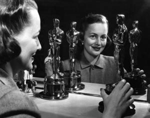"""Olivia de Havilland poses with both her """"Oscars""""1950** I.V. - Image 24383_0072"""