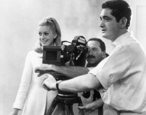 "Catherine Deneuve, cinematographerJean Rabier and director Jacques Demy on the set of ""The Umbrellas Of Cherbourg""1964 ** I.V. - Image 24383_0335"