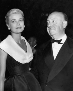 """Grace Kelly (wearing the Caracas dress, Christian Dior-New York collection, Spring-Summer 1954) at the premiere of """"Rear Window"""" with director Alfred Hitchcock1954** I.V. - Image 24383_0771"""
