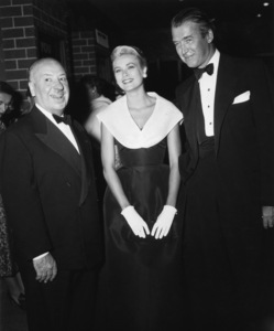 """Grace Kelly (wearing the Caracas dress, Christian Dior-New York collection, Spring-Summer 1954) at the premiere of """"Rear Window"""" with director Alfred Hitchcock and James Stewart1954** I.V. - Image 24383_0773"""