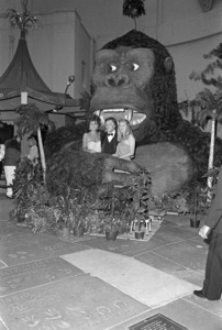 """Carrie Leigh, Hugh Hefner and Hope Olson attend the 50th Anniversary screening of """"King Kong"""" at Grauman"""