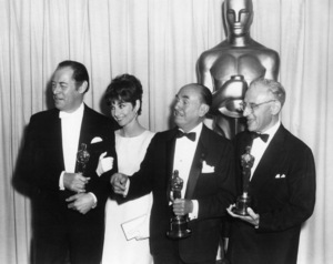 """Rex Harrison, Audrey Hepburn, Jack Warner and George Cukor pose with the Oscars they won for """"My Fair Lady"""" at """"The 37th Annual Academy Awards"""" at the Santa Monica Civic Auditorium in Santa Monica, California1965** B.D.M. - Image 24384_0077"""