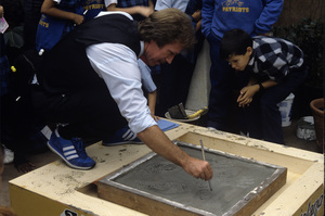 Chuck Norris signs his name in cement at the Hollywood Wax Museumcirca 1980s© 1980 Jean Cummings - Image 24385_0030
