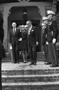 James Stewart and his wife, Gloria, attend the funeral of 1LT Ronald Walsh McLean (son of Gloria Hatrick Stewart, and stepson of James Stewart. He was killed in action in Vietnam)1969** J.C.C. - Image 24385_0053