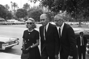 James Stewart and his wife, Gloria, attend the funeral of 1LT Ronald Walsh McLean (son of Gloria Hatrick Stewart, and stepson of James Stewart. He was killed in action in Vietnam)1969** J.C.C. - Image 24385_0054