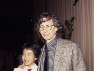 """Director Steven Spielberg and Ke Huy Quan during an event for """"Indiana Jones and The Temple Of Doom""""1984© 1984 Jean Cummings - Image 24385_0086"""