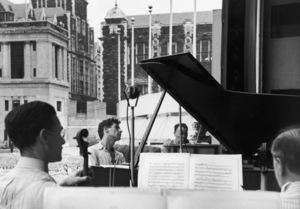 Leonard Bernstein during a practice of the New York Philharmonic at Lewisohn Stadium in New York City 1947© 1978 Ruth Orkin - Image 24388_0018