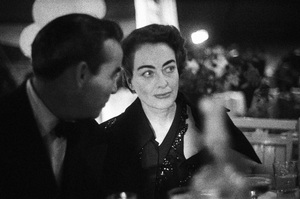 Joan Crawford at a party hosted by Marion Davies1950© 1978 Ruth Orkin - Image 24388_0050