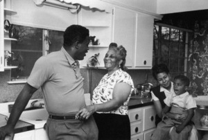 Jackie Robinson at home in New York with his mother Mallie (McGriff), his wife Rachel (Isum) and his son Jackie Jr.1949 © 1978 Ruth Orkin - Image 24388_0059