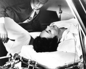 Jennifer Jones is placed in an ambulance as she was transferred from the emergency hospital November 9, 1967 to Mt. Sinai in Los Angeles.  She was found unconscious in the surf at the base of a 400-foot cliff - Image 2535_0102