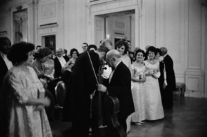 Pablo Casals whispering to John F. Kennedy on the night he performed at the White House (Jacqueline Kennedy on right)1961 © 2010 Mark Shaw  - Image 2554_0177
