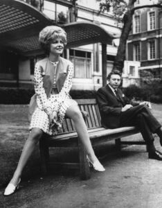 Virna Lisi perched on a park bench in London, England / 1968 - Image 2603_0013