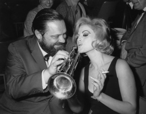 Virna Lisi in New Orleans, Louisiana being given a trumpet lesson by jazzman Al Hirt at his Bourbon Street night club / 1965 - Image 2603_0014
