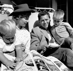 Gordon Macrae with wife Sheila, kids Bruce and Meredith at home, 5/8/55. © 1978 Sid Avery - Image 2636_0040