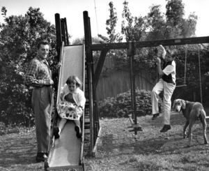 Robert Mitchum with children Petrine and Christopher at home, 4/23/55. © 1978 Sid Avery - Image 2706_0121