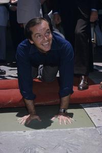 Jack Nicholson putting his hand and footprints at Grauman