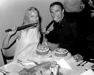 """Burt Reynolds and Barbara Loden, during a break in filming """"Fade-In,"""" hold an impromptu birthday party1967 Paramount Pictures - Image 2868_0204"""