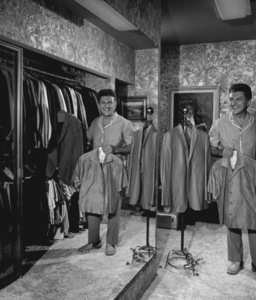 Lee Liberace at home in his walk-in closet with his mirror reflection, circa 1960. © 1978 Eric SkipseyMPTV - Image 289_314