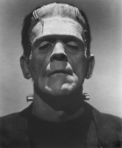 Boris Karloff in character as Frankenstein