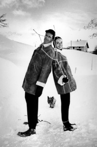 Audrey Hepburn and Mel Ferrer back-to-back in the snow with their pet dog, Famous, 1959. © 1978 Sanford Roth AMPASMPTV - Image 33_2247