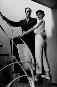 Audrey Hepburn and Mel Ferrer standing on a staircase, circa 1956. © 1978 Bill AveryMPTV - Image 33_2251