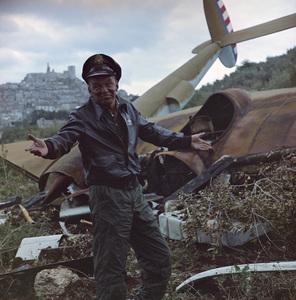 """Frank Sinatra standing next to airplane wreckage for """"Von Ryan"""