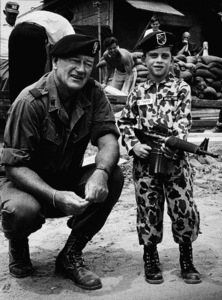"""The Green Berets,"" Warner Bros. 1967.John Wayne and his son, Ethan, during a break from filming. © 1978 David Sutton - Image 3469_0192"