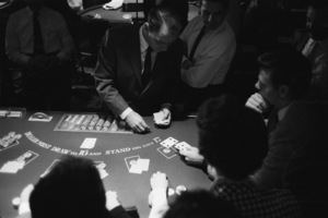Frank Sinatra at the Sands Hotel in Las Vegas deals cards at the Blackjack table1960 © 1978 Bob Willoughby - Image 3625_0103