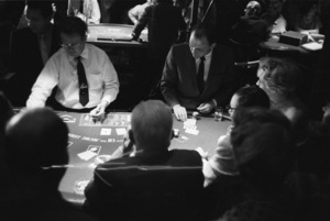 Frank Sinatra at the Sands Hotel in Las Vegas deals cards at the Blackjack table1960 © 1978 Bob Willoughby - Image 3625_0104