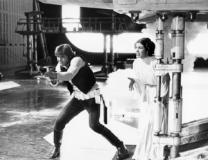 """""""Star Wars"""" Harrison Ford and Carrie Fisher1977 Lucasfilm© 1978 John Jay - Image 3748_0157"""