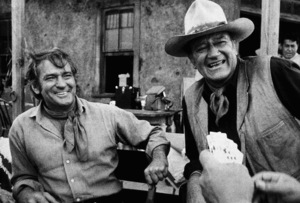 """""""The Train Robbers,"""" Warner Bros. 1973.Rod Taylor and John Wayne during a break from filming. © 1978 David Sutton - Image 3785_0138"""