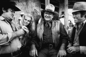 """""""The Train Robbers,"""" Warner Bros. 1973.Rod Taylor, Ann-Margret, John Wayne, and Bobby Vinton during a break from filming. © 1978 David Sutton - Image 3785_0139"""