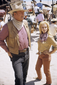 "John Wayne and Ann-Margret on the set of ""The Train Robbers""1973 Warner Bros.© 1978 David Sutton - Image 3785_0155"