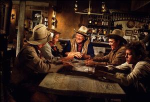 """The Train Robbers,"" Warner Bros. 1973.Rod Taylor, John Wayne, and Ben Johnson. © 1978 David Sutton - Image 3785_0168"