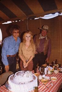 """The Train Robbers,"" Warner Bros. 1973.Roger Smith, Ann-Margret, and John Wayne celebrating her birthday on the set. © 1978 David Sutton - Image 3785_0178"