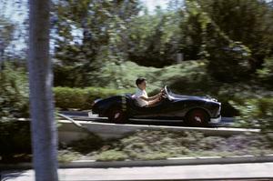 CarsRon Avery on the Autopia ride at Disneyland1964© 1978 Sid Avery - Image 3846_0294