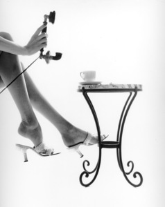 Legs CategoryLegs, table and telephone for a Mademoiselleeditorial circa 1950 © 2002 Mark Shaw - Image 3865_0002