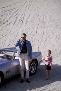 James Coburn and his son, James H. Coburn IV, with his Ferrari 250 GT California at his Los Angeles home1966© 1978 David Sutton - Image 3893_0134