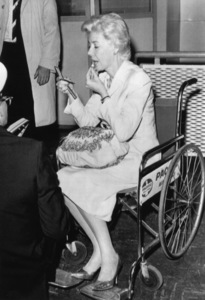 Marie McDonald at an Australian airport en route to Los Angeles (in a wheelchair because of a bleeding ulcer)April 1963 - Image 3947_0426